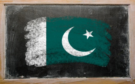 Chalky Pakistan flag painted with color chalk on old blackboard photo