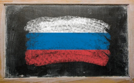 Chalky russian flag painted with color chalk on old blackboard photo