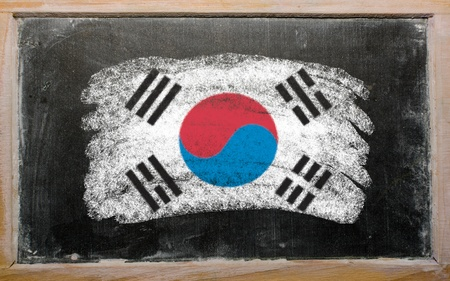 Chalky South Korean flag painted with color chalk on old blackboard photo