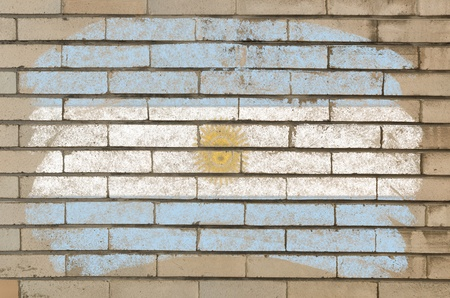Chalky argentinian flag painted with color chalk on grunge old brick wall photo