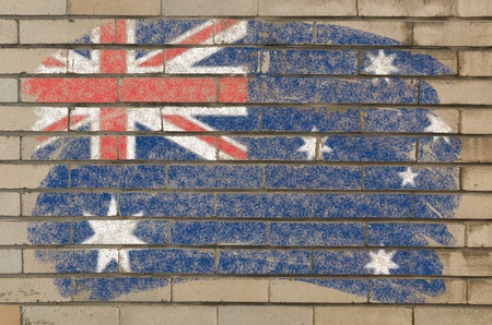 Chalky  australian flag painted with color chalk on grunge old brick wall photo