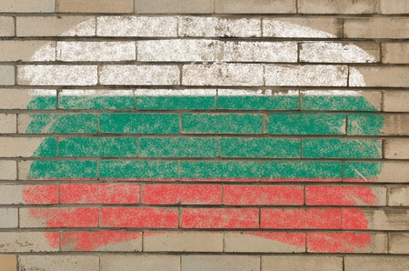 Chalky bulgarian flag painted with color chalk on grunge old brick wall photo