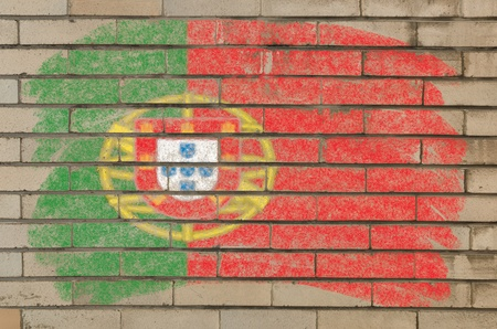 portugese: Chalky portugese flag painted with color chalk on grunge old brick wall