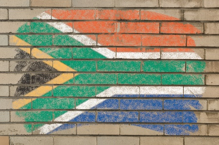 Chalky  south african republic flag painted with color chalk on grunge old brick wall photo