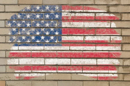 Chalky united states of america flag painted with color chalk on grunge old brick wall photo