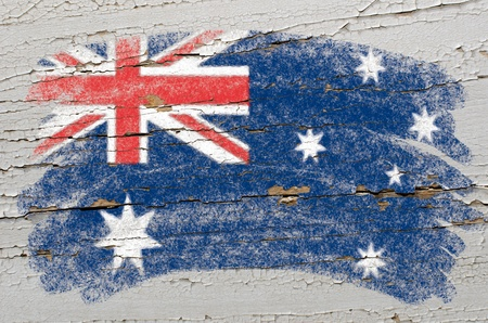 Chalky australian flag painted with color chalk on grunge wooden texture photo