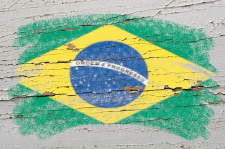 wrote: Chalky brazilian flag painted with color chalk on grunge wooden texture