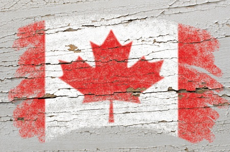 Chalky canadian flag painted with color chalk on grunge wooden texture photo