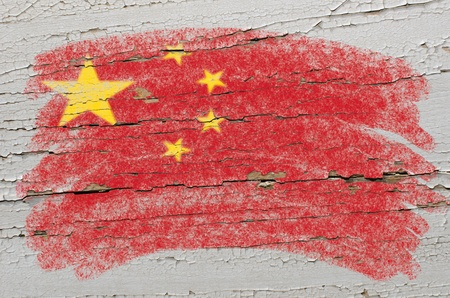 Chalky chinese flag painted with color chalk on grunge wooden texture Stock Photo - 10605950
