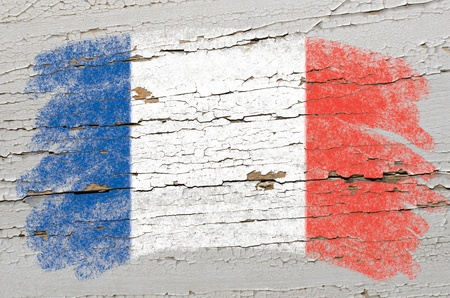 france painted: Chalky frech flag painted with color chalk on grunge wooden texture