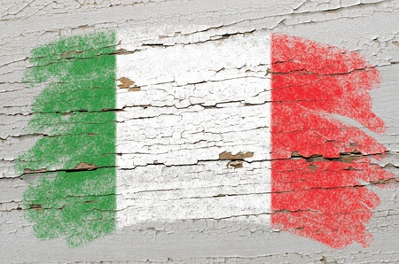 Chalky italian flag painted with color chalk on grunge wooden texture Stock Photo - 10606056