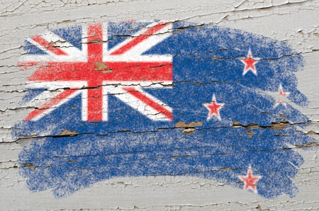 Chalky new zealand flag painted with color chalk on grunge wooden texture Stock Photo - 10605953