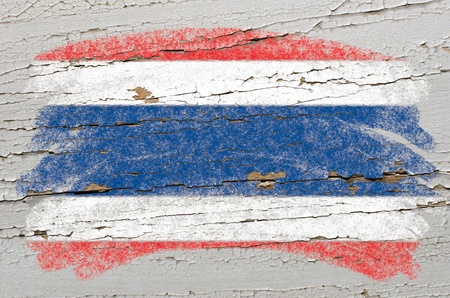 thai language: Chalky thai flag painted with color chalk on grunge wooden texture