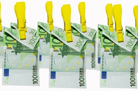 euro banknotes hanging on clothespins on white background photo