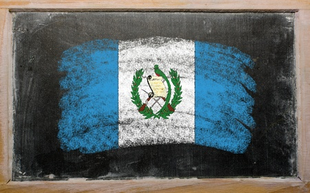 guatemalan: Chalky guatemalan flag painted with color chalk on old blackboard Stock Photo
