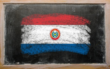 Chalky paraguay flag painted with color chalk on old blackboard photo