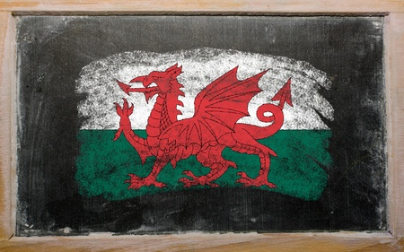 welsh flag: Chalky welsh flag painted with color chalk on old blackboard Stock Photo