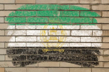 afghan flag: Chalky afghan flag painted with color chalk on grunge old brick wall Stock Photo