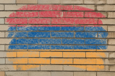 armenian: Chalky armenian flag painted with color chalk on grunge old brick wall