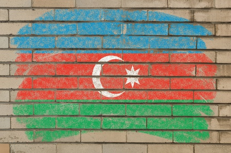 Chalky azerbaijan flag painted with color chalk on grunge old brick wall photo