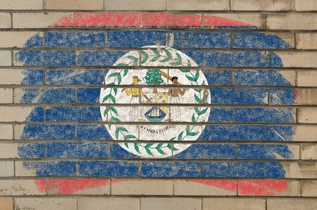 belize: Chalky belize flag painted with color chalk on grunge old brick wall Stock Photo