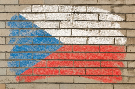 Chalky czech flag painted with color chalk on grunge old brick wall photo