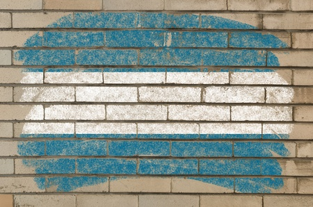 Chalky el salvador flag painted with color chalk on grunge old brick wall photo
