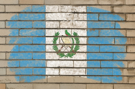 guatemalan: Chalky guatemalan flag painted with color chalk on grunge old brick wall Stock Photo