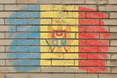 Chalky moldova flag painted with color chalk on grunge old brick wall Stock Photo - 10829197