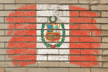Chalky  flag painted with color chalk on grunge old brick wall photo