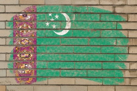 turkmenistan: Chalky turkmenistan flag painted with color chalk on grunge old brick wall Stock Photo