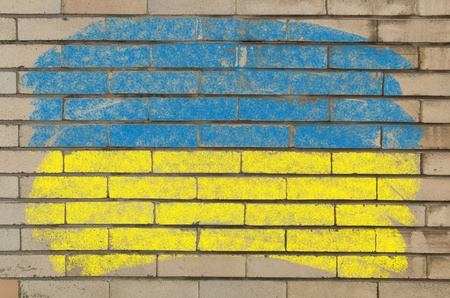 Chalky ukrainian flag painted with color chalk on grunge old brick wall photo