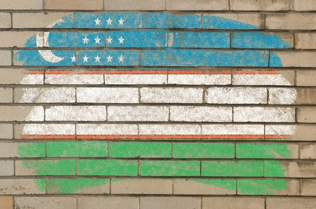 uzbekistan: Chalky uzbekistan flag painted with color chalk on grunge old brick wall Stock Photo