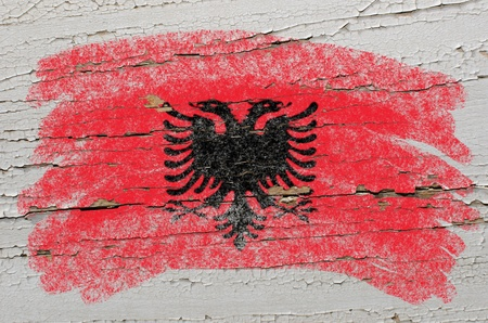 albanian: Chalky albanian flag painted with color chalk on grunge wooden texture Stock Photo