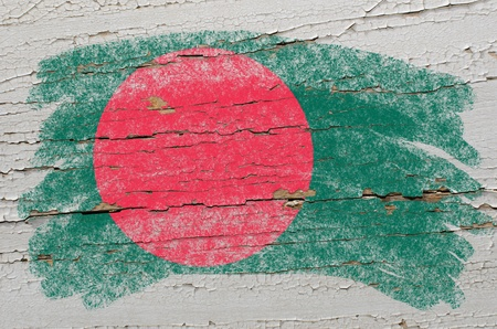 national emblem: Chalky bangladesh flag painted with color chalk on grunge wooden texture