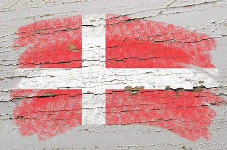 danish flag: Chalky danish flag painted with color chalk on grunge wooden texture Stock Photo