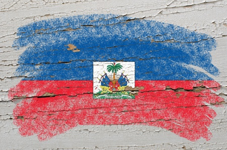 haitian: Chalky haitian flag painted with color chalk on grunge wooden texture Stock Photo