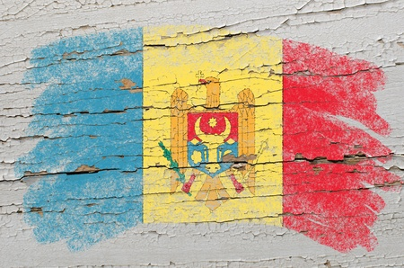 Chalky moldova flag painted with color chalk on grunge wooden texture Stock Photo - 10829122