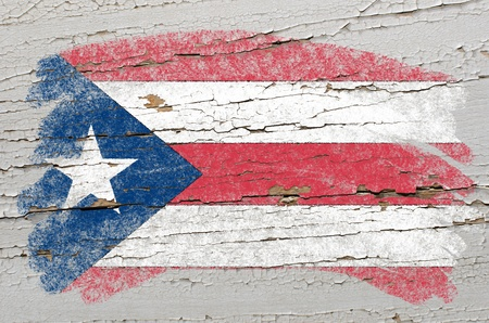 puertorico: Chalky puertorican flag painted with color chalk on grunge wooden texture Stock Photo