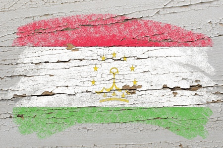 tajikistan: Chalky tajikistan flag painted with color chalk on grunge wooden texture