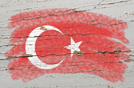Chalky turkish flag painted with color chalk on grunge wooden texture photo