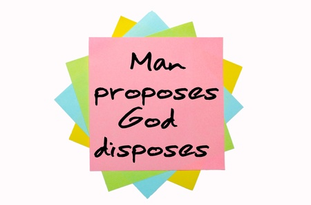 proposes: text Man proposes, God disposes written by hand font on bunch of colored sticky notes