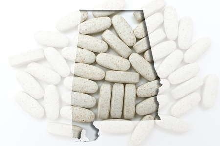 Outlined alabama map with transparent background of capsules Stock Photo