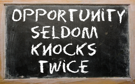 Blackboard writings &quot,Opportunity seldom knocks twice&quot, Stock Photo