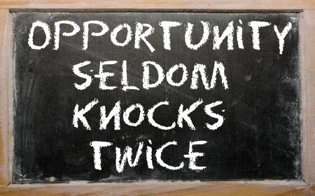 """Blackboard writings """",Opportunity seldom knocks twice"""", Reklamní fotografie"""