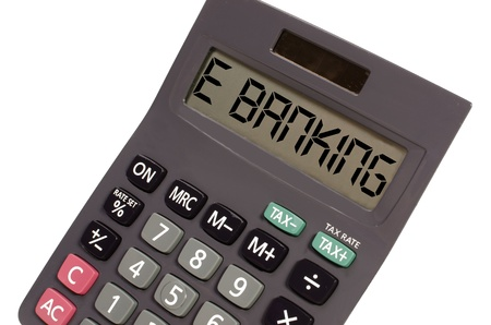 budgetary: e banking written on display of an old calculator on white background in perspective
