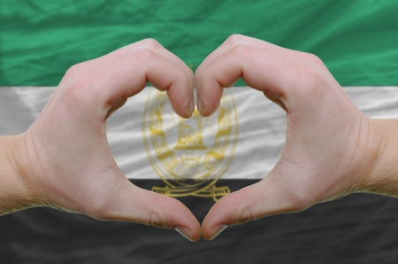 afghan flag: Gesture made by hands showing symbol of heart and love over Afghanistan flag
