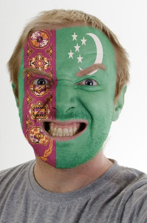 turkmenistan: High key portrait of an angry man whose face is painted in colors of turkmenistan flag Stock Photo