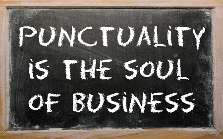 punctuality: Blackboard writings &quot,Punctuality is the soul of business&quot,