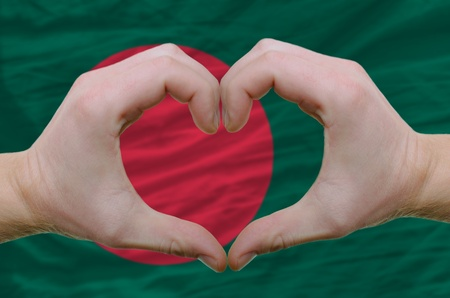 bangladesh: Gesture made by hands showing symbol of heart and love over bangladesh flag
